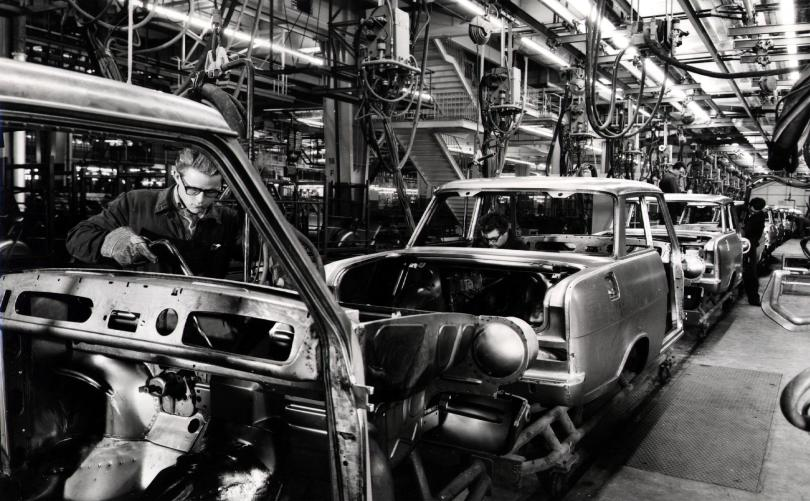 Man working on car assembly plant in 20th century