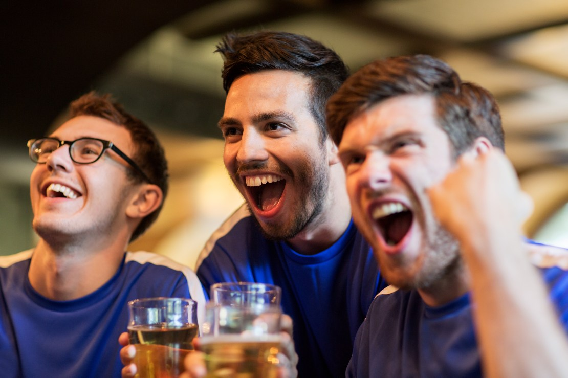 People mixing in a pub watching sport