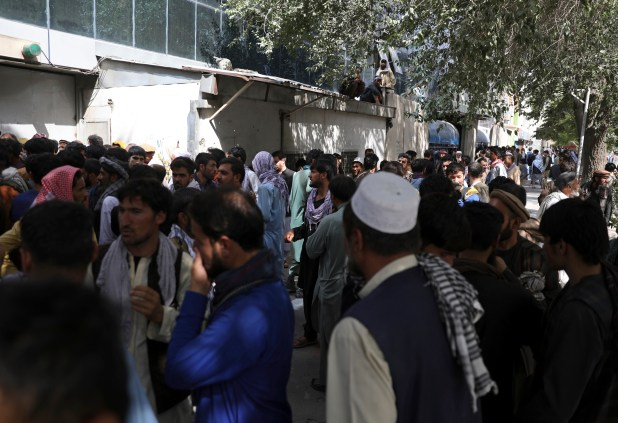 Crowds of Afghans trying to take money out of the bank in Kabul.