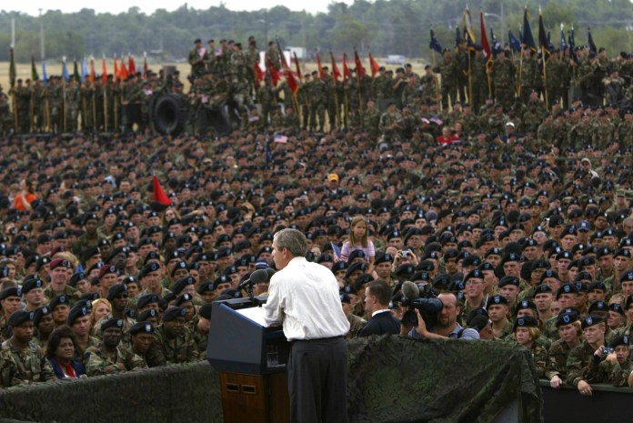 President George W. Bush addressing US troops.