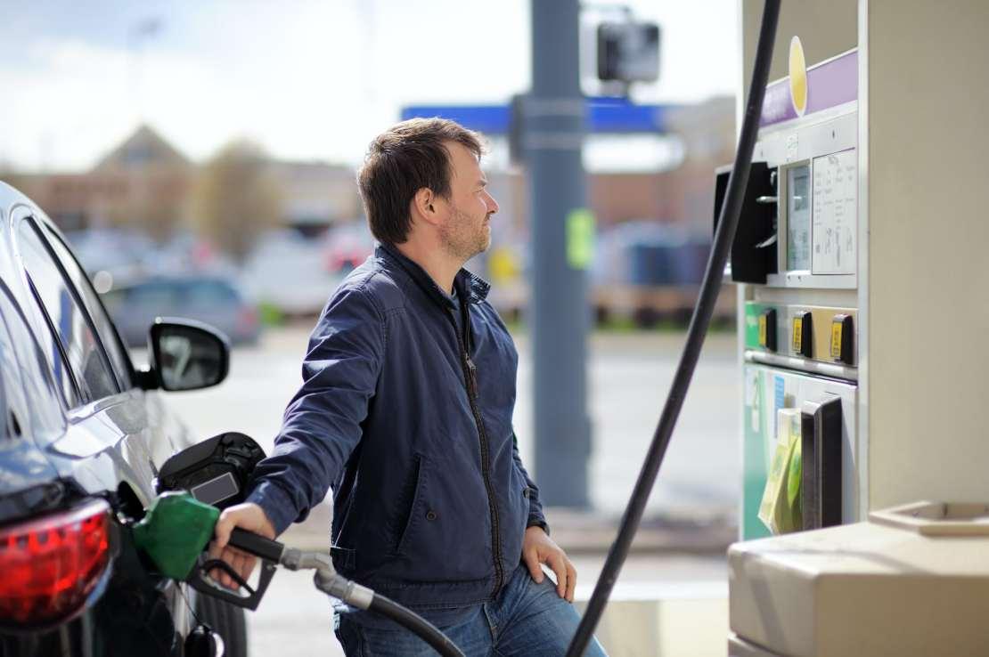 A man fills up his car with petrol.