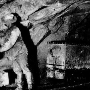 Miner with ore carts at the 1,000 foot station of the Empire Mine, Grass Valley District