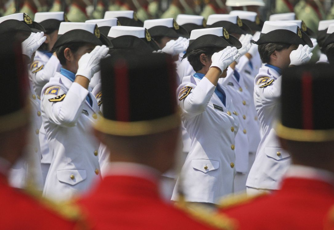 Female Members Of Indonesian Navy Salute In Jakarta In An Aug