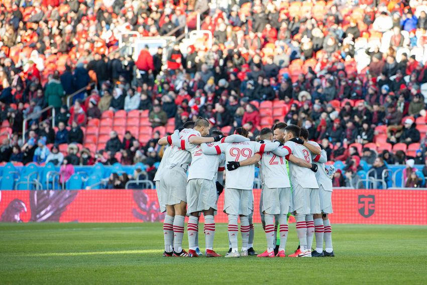 Toronto FC players huddle up at the start of their last home date before the pandemic shut out home fans — March 7, 2020 against New York City FC at BMO Field.