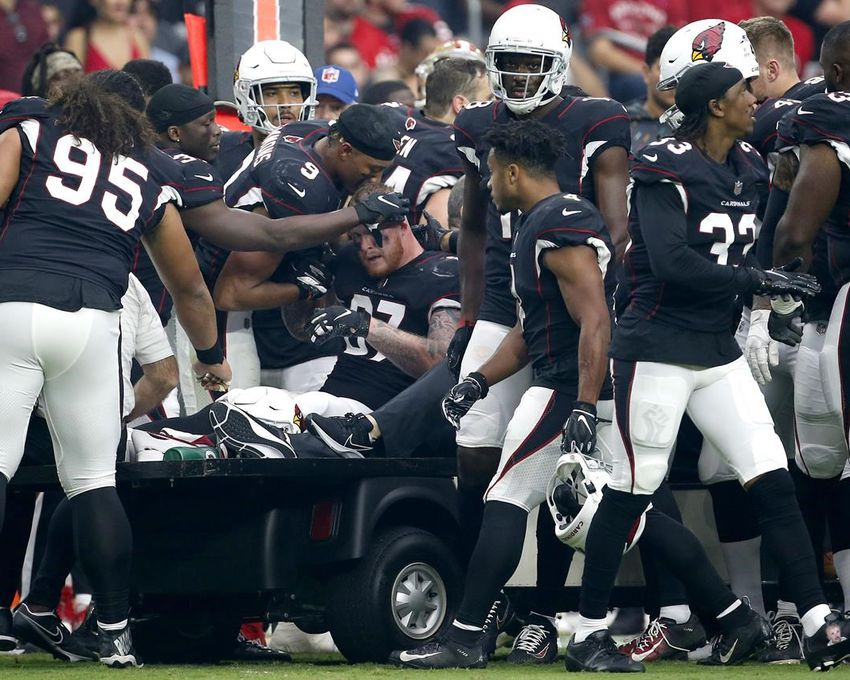 Teammates speak with Arizona Cardinals tight end Maxx Williams (87) as he leaves the game with an injury during the first half of an NFL football game against the San Francisco 49ers, Sunday, Oct. 10, 2021, in Glendale, Ariz.