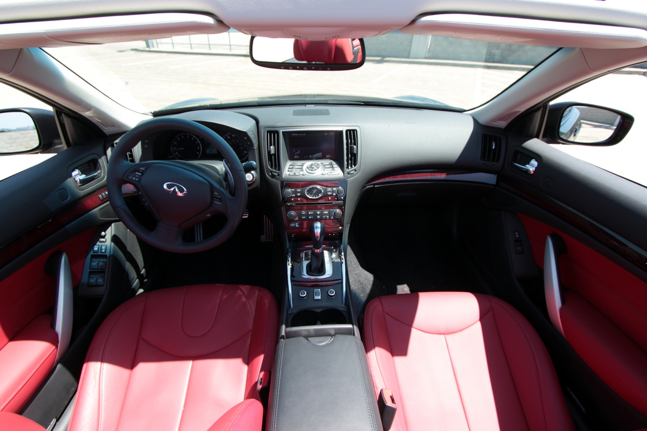 Review 2011 infiniti g37 convertible limited edition the truth from the drivers perspective there is little difference between the convertible and the coupe inside the cabin the g37s three spoke steering wheel vanachro Choice Image