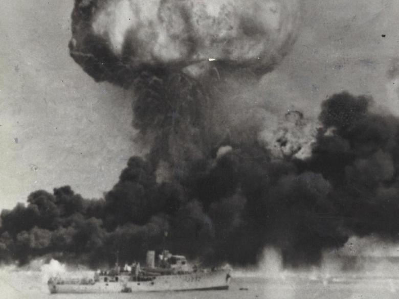 Ammunition ship MV Neptuna explodes during the February 1942 raid as HMAS Deloraine heels over from the blast. Picture: Herald Sun
