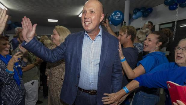 Federal Member for Dickson, Peter Dutton, arrives to celebrate the win of the Dickson electorate against Ali France .