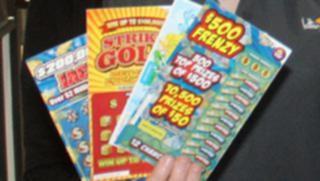 Scratchie winner shares cash with newsagent