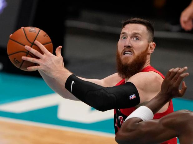 Toronto Raptors' Aron Baynes plays against the Charlotte Hornets during the first half of an NBA preseason basketball game in Charlotte.