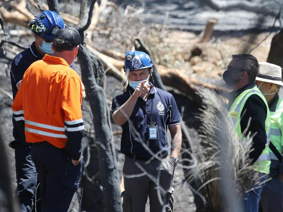 Arson squad detectives at what they believe could be the Wooroloo bushfire's ground zero.