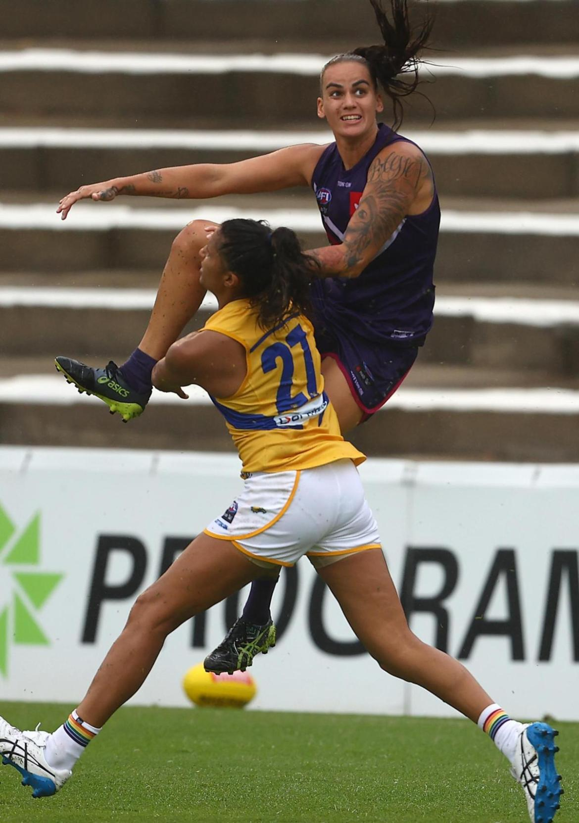 Gemma Houghton snaps a goal over her shoulder in the second term.