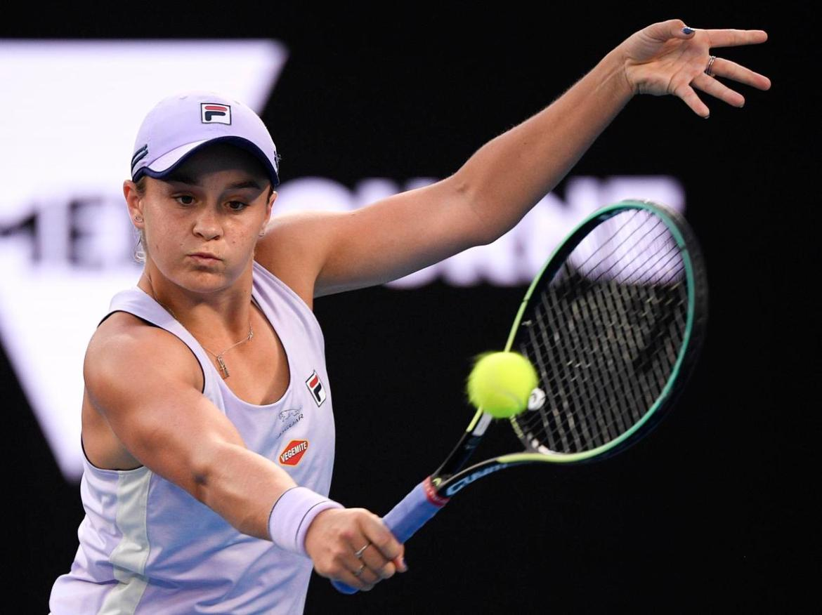 Australia's Ash Barty hits a backhand return to United States' Shelby Rogers during their fourth round match at the Australian Open tennis championship.