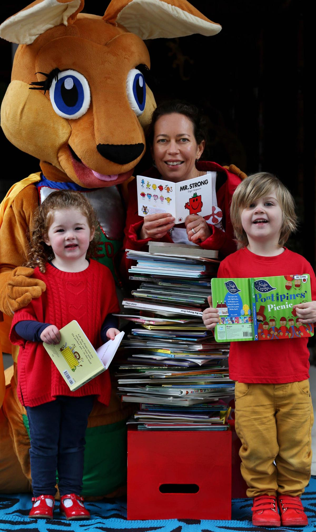Red the Reading Roo mascot with Justine and children