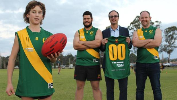 Tigers Thomas Walker, 13, Shaun Hodgson and Daniel Ward have third and fourth generation links with the Jardee Football Club. The player model the jerseys with sponsor Nathan Walter (back centre).