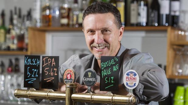 Happier times: Parade Taphouse owner shows off some of the pub's craft beer after taking over the venue.