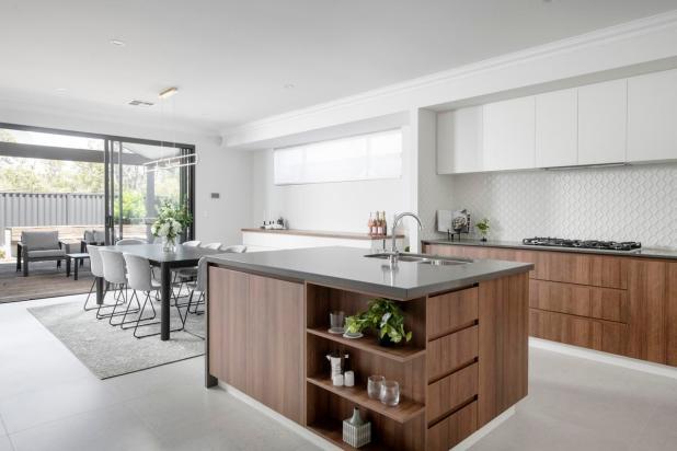 The wraparound corner kitchen features an island bench with plenty of storage space.