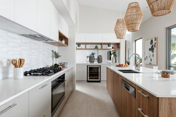 The galley-style kitchen, larder and laundry are seamlessly integrated, making it easy to multi-task.