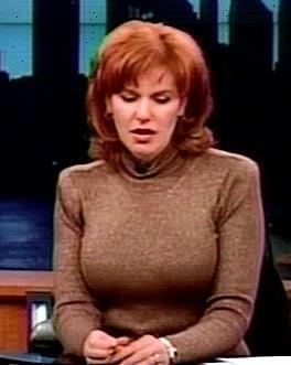 women in tight sweaters