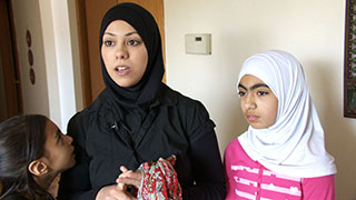 American Arab woman and daughter wearing their hijab