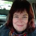 Woman in car smiling