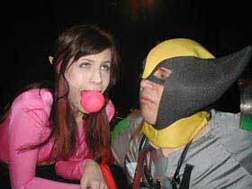 The superhero Electra Elf is gagged by the supervillain Captain SUV