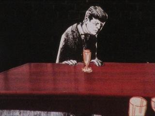 President John F. Kennedy drunk at a bar