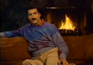 Baseball player Keith Hernandez sitting in front of a fire