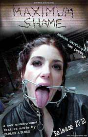 Woman wearing extreme mouth gear sticks out her tongue