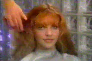 Red haired woman sitting in a beauty parlor chair