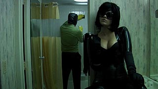 Dominatrix waits while her male slave cleans at bathroom