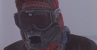 Woman wearing a ski mask and goggles