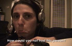 Julie Perrini wearing headphones in Girl Next Door