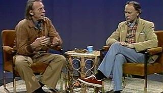 Jonas Mekas being interviewed by Robert Gardner on a public access TV show set