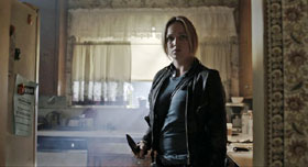 Caity Lotz holds a knife in The Pact