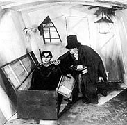 Still from The Cabinet of Dr. Caligari where Caligari greets Cesare rising from coffin