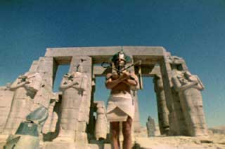 Film still of Lucifer Rising by Kenneth Anger featuring a Pharoh in front of ruins