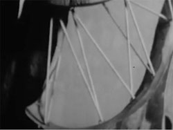 Film still from Visual Variations on Noguchi featuring bike wheel spokes