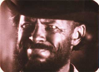 Film still from Quick Billy featuring Bruce Baillie as a cowboy