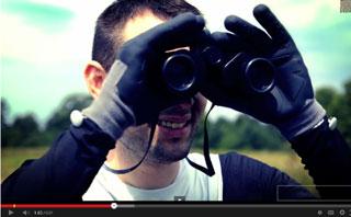 Superhero looks through binoculars