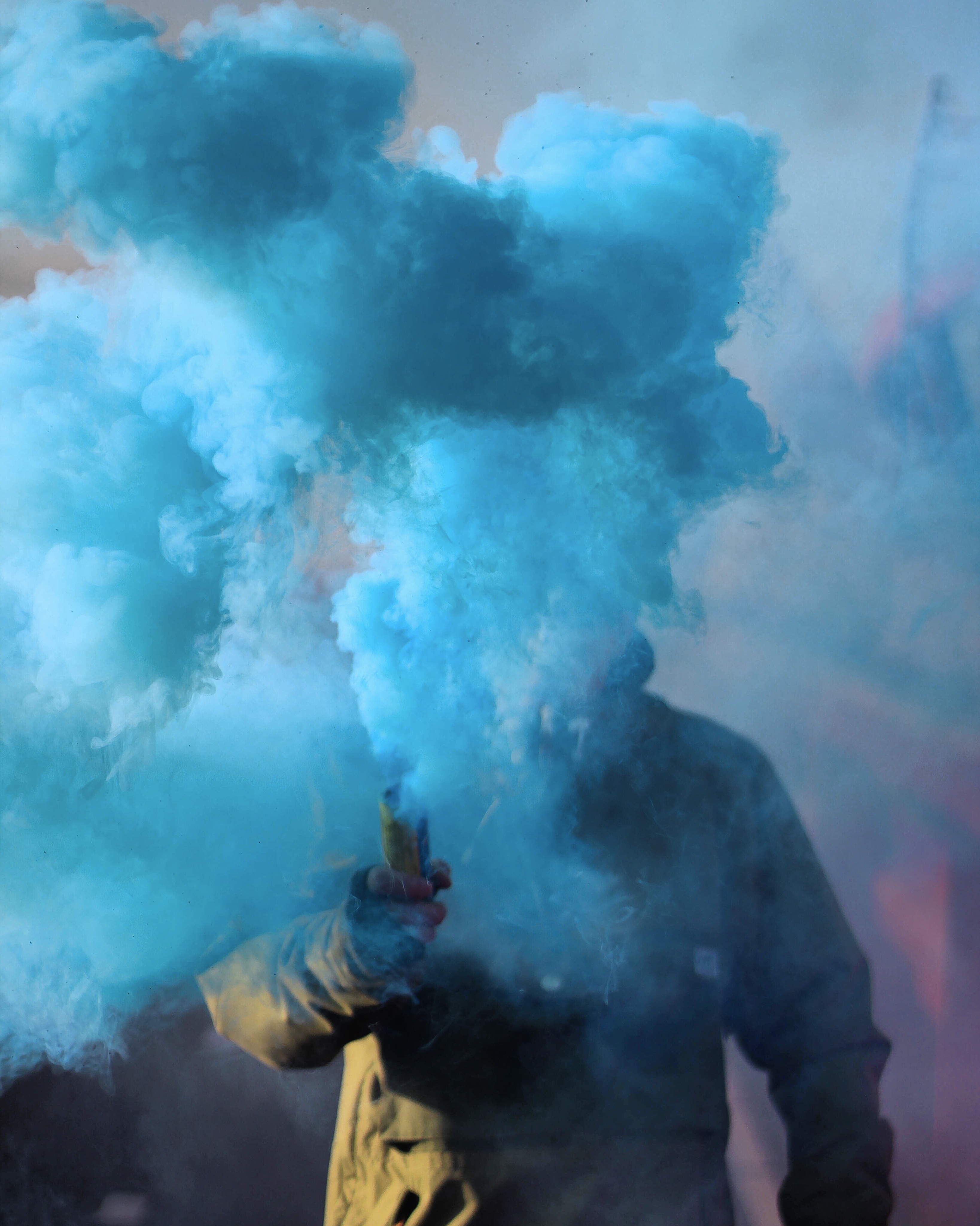 Smoke Bomb Pictures   Download Free Images on Unsplash person holding stick with blue smoke