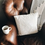 Square White Throw Pillow On Brown Leather Sofa Chair Photo Free Home Image On Unsplash