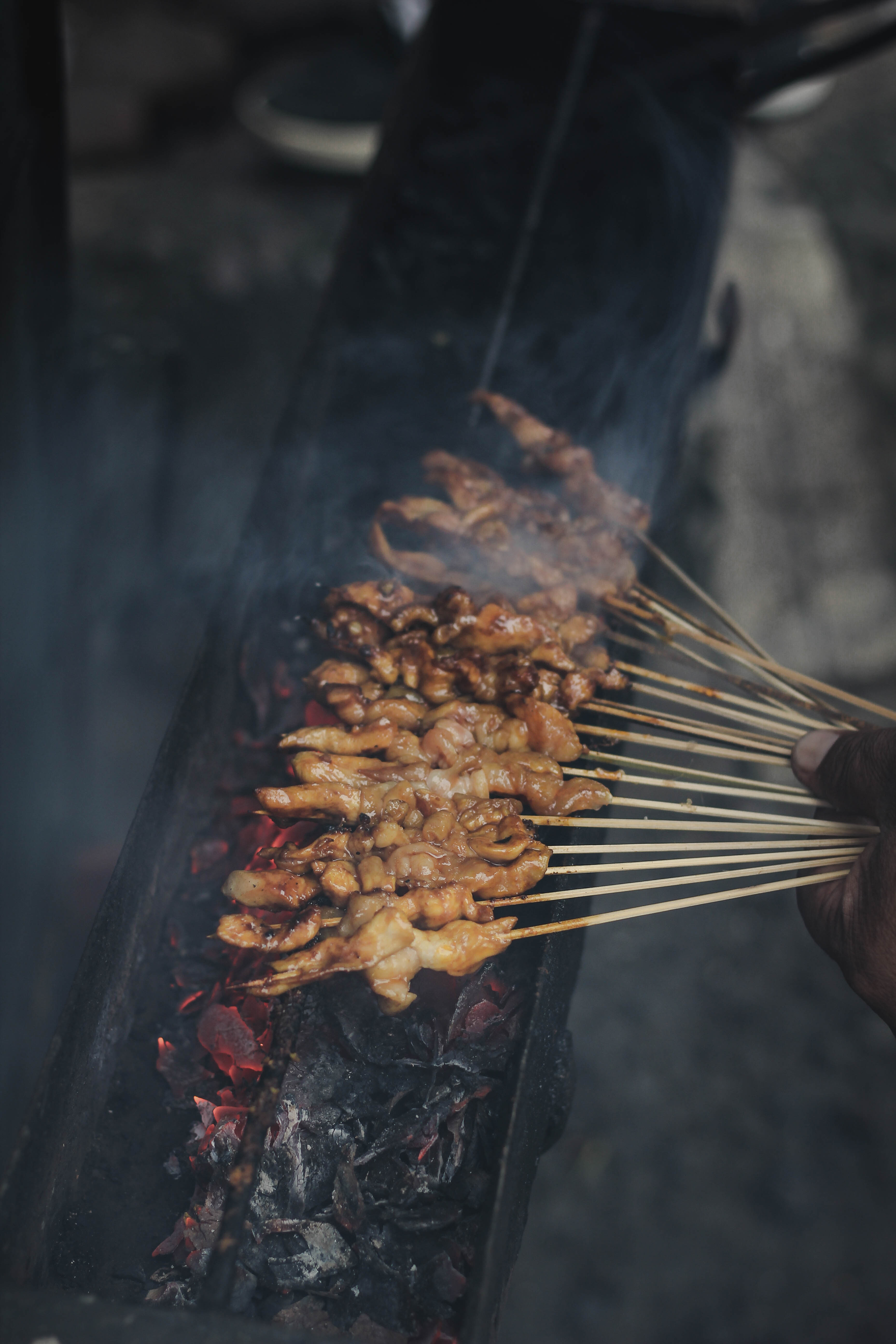 500  Street Photography Pictures  HQ    Download Free Images on Unsplash person holding skewered meat