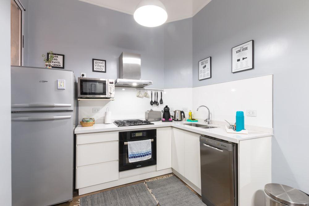 white top mount refrigerator beside