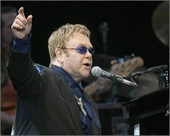 Singer Elton John performs during his concert at the Bell Center in Montreal, Saturday. In an interview in Music Monthly magazine John was quoted as saying that organized religion turns people into really hateful lemmings.
