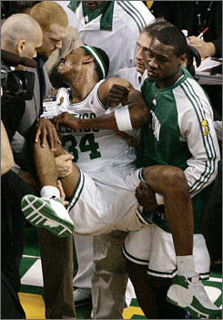 Celtics teammates gloomily carried Paul Pierce off the court during the third period with what appeared to be a severe injury.