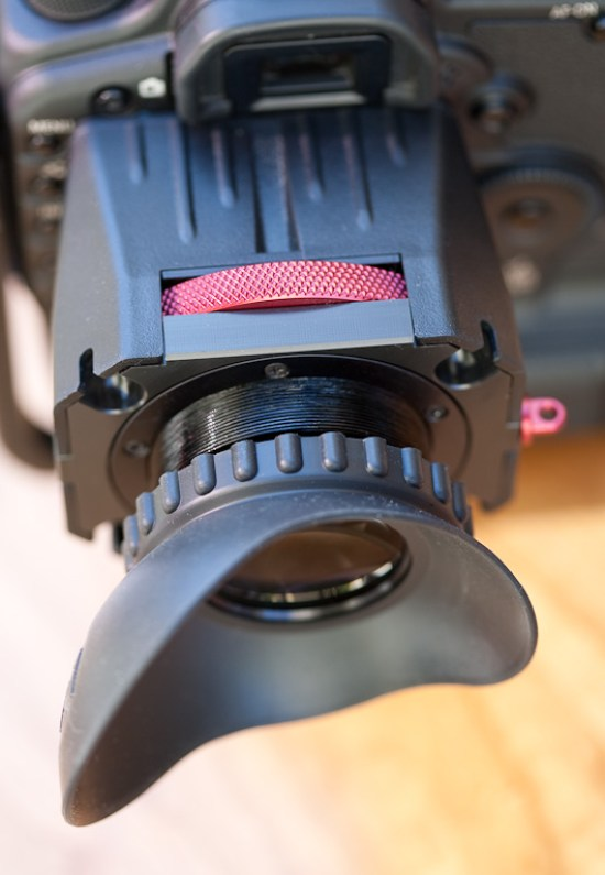 Zacuto's Z-Finder, the red wheel is the diopter adjustment