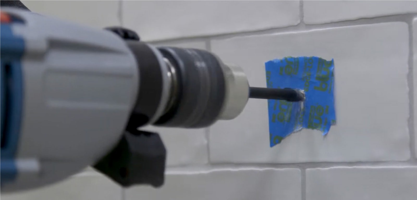 how to drill through a tile without