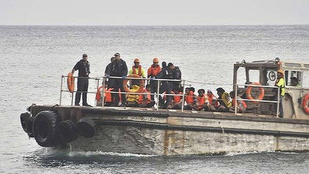 A barge carrying rescued suspected asylum seekers nears Christmas Island