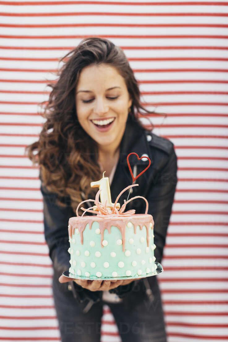 Woman Presenting Birthday Cake Stockphoto